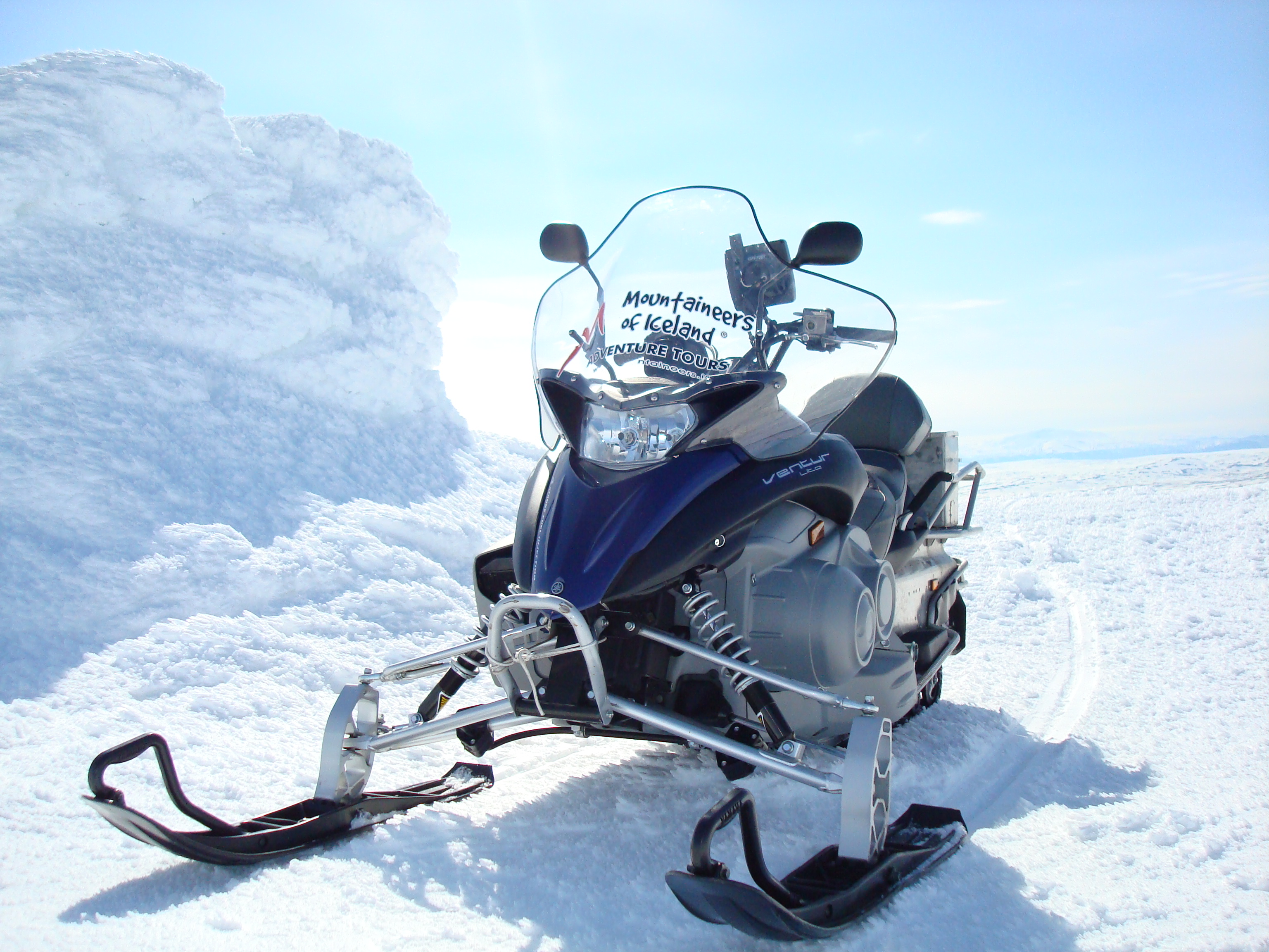 Snowmobile Adventure At Langjokull Glacier Guide To Iceland - This is what happens when you fly a snowmobile off a cliff