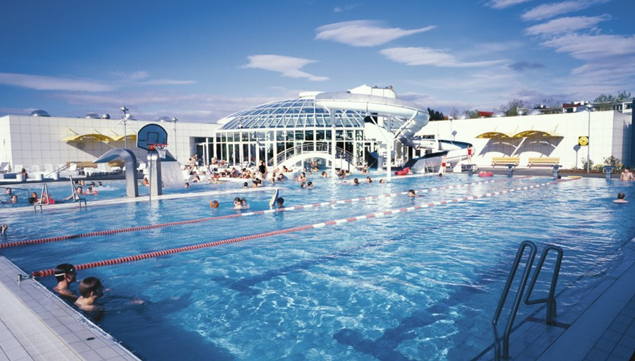 the best swimming pools in reykjavik relax in hot tubs